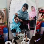 Afghan girls practice beauty care
