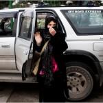 Bibi Aisha exiting SUV