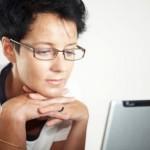 Woman reading computer